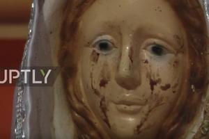 Статуя Девы Марии заплакала кровавыми слезами. Загадочное видео
