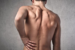 Болі в спині у чоловіків