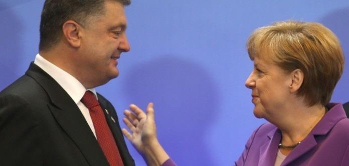 Меркель, Путин иМакрон обсудили ситуацию навостоке Украины— 2-ой день саммита