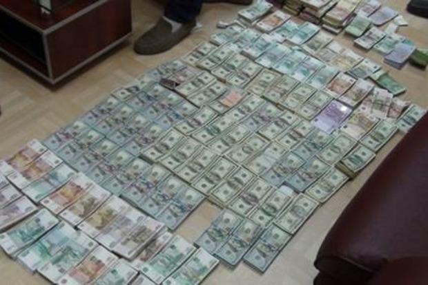 В Мелитополе в «обменнике» боевиков изъяли более полумиллиона долларов