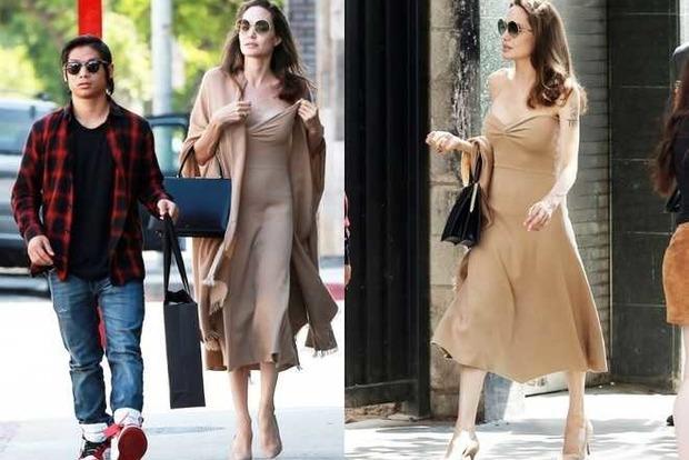 Грудь вываливалась. Джоли прогулялась с сыном в нескромном наряде