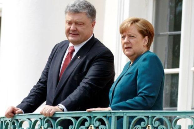 Меркель позвала Порошенко, Макрона и Путина обсудить войну на Донбассе