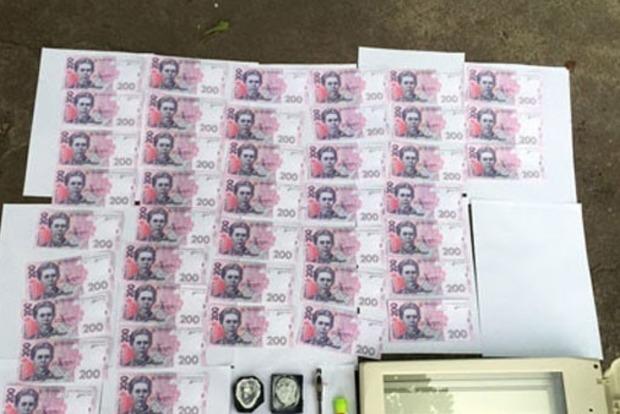 В Мариуполе четверо человек сбывали фальшивые гривни