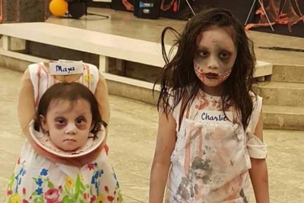Маленькая девочка пришла на праздник Хеллоуин без головы