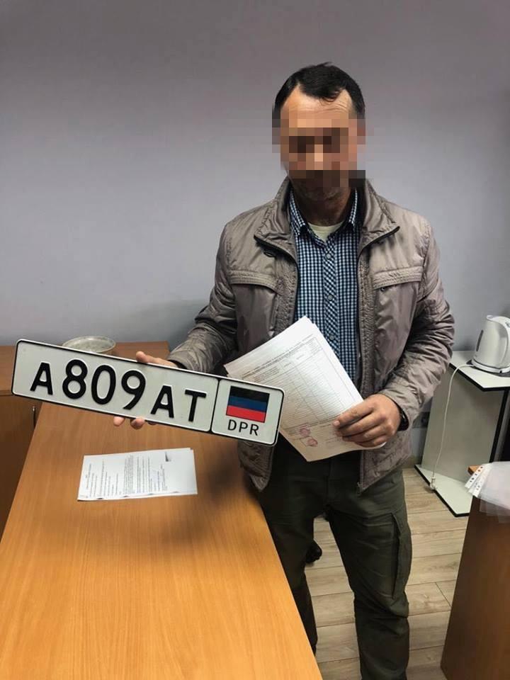 Киев, автомобиль Peugeout, номера ДНР, страховая компания, Интерпол